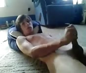 Sloan strokes his cock fast and cums