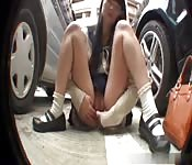 Mini-skirt clad Asian whore masturbating in public