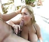 Chubby girl with big tits fucks in the pool
