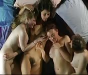 Four hot lesbians tangle their bodies in bed
