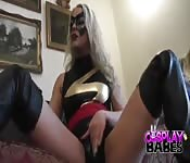 Masked cosplay blonde shows off and plays with herself
