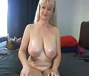 Granny's oiled tits are truly fascinating