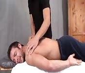 Handsome masseur sucks and strokes client