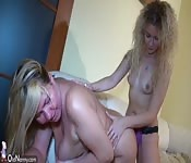 Mature MILF teaching her stepdaughter to scissor