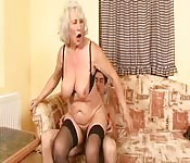 Horny old broad masturbates before she is banged by a young buck
