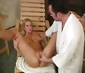 Tempting oiled-up hussy getting her shaved snatch fingered