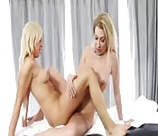 Blonde mistresses finger and scissor on the massage table