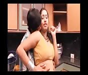 Good-looking Indian woman getting felt up in her kitchen