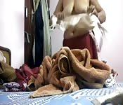 Indian MILF gets dressed in her room