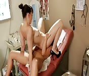 High-heeled lesbian doctor sitting on a patient's face