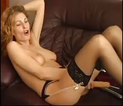 Horny MILF masturbates with a big dildo