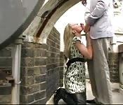 Mature British tramp sucking a random guy's big cock