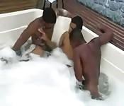 Three men enjoy their time in the bathtub
