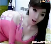 Gorgeous Asian cam girl teases with a toy