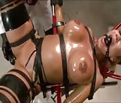 Red-haired MILF endures the roughest BDSM