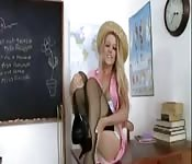 Sexy blonde teacher stripteases in her classroom