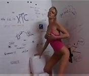 Horny babe is a huge fan of bathroom glory holes