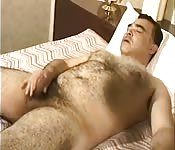 Chubby man with hairy body jerks off his cock