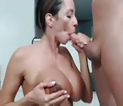 Busty MILF sucks cock with style during a cam show