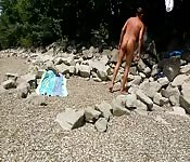 Sunbathing guy strokes cock