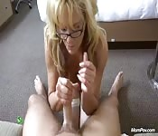 Milf broad giving a nice handjob and blowjob