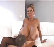 Milf with massive tits plays