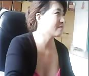 Chinese lady strips in front of her office webcam