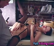 Lingerie-clad ho getting fisted in her kitchen