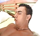 Two Brazilain guys bang each other on the bed