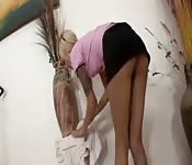 Hot blonde caught with her skirt up as she cleans up the house