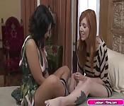 Busty redhead licks shy latinas pussy