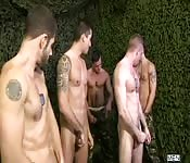 Several gay men engage in group sex