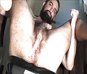 Bearded man jerks himself off