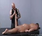 Bald tattooed man gives blowjob during massage