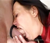 Dame deepthroats before a dude fucks her in the ass, with a dildo stuck in her cunt