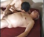 Older Japanese men enjoy threesome