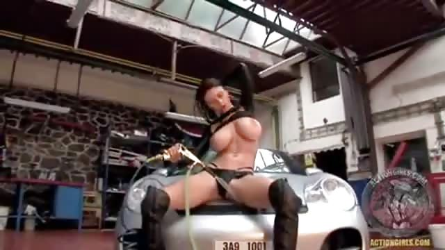 Busty female mechanic strips nude in the garage