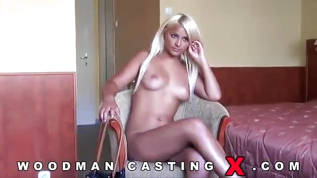 Blonde takes two cocks